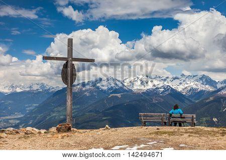 Summit cross on the Kronplatz (2275 m) above Brunico South Tyrol Italy poster