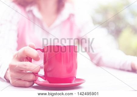 Woman Holding Hot Red Cup Of Coffee