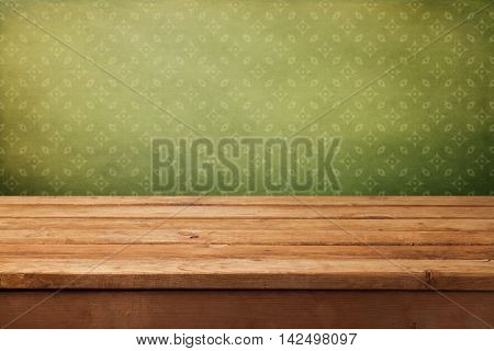 Vintage background with empty wooden deck table over retro wallpaper