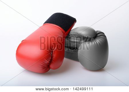 Pair of red and black and white color leather boxing gloves