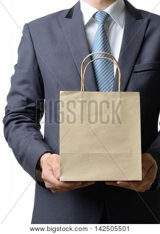 businessman hold a paper bag with both handbusiness concept