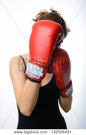 asian woman with the red boxing gloves guard her face on white background