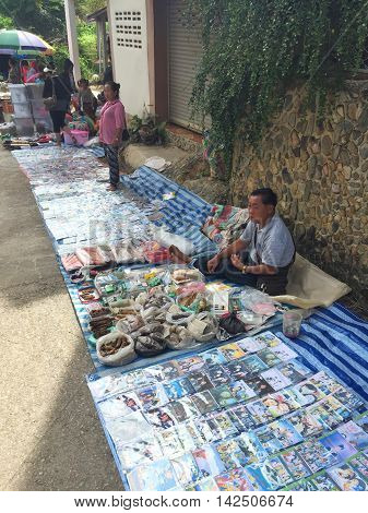 CHIANG RAI THAILAND - AUGUST 9 : horizontal photo of copyright violations of CDs are sold at a market at the Thai-Laos frontier on August 9 2016 in Chiang rai Thailand. This is one of travel attraction in Chiang Rai