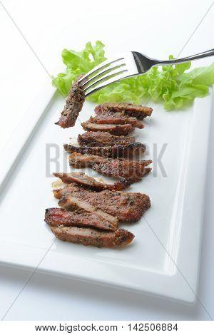 roast beef sliced on white plateThai food
