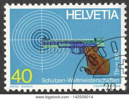 MOSCOW RUSSIA - CIRCA APRIL 2016: a post stamp printed in SWITZERLAND devoted to World Marksmanship Championship Thun circa 1974