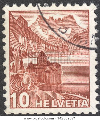 MOSCOW RUSSIA - CIRCA MAY 2016: a post stamp printed in SWITZERLAND shows Chillon castle at Lake of Geneva & Dents du Midi the series