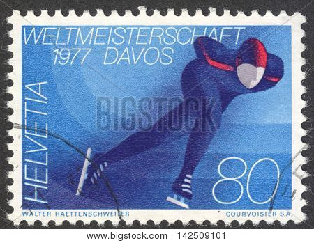 MOSCOW RUSSIA - CIRCA APRIL 2016: a post stamp printed in SWITZERLAND dedicated to the World Speed Skating Championships Davos 1977 circa 1976