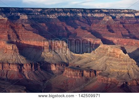 Golden light illuminates the Grand Canyon in the late afternoon