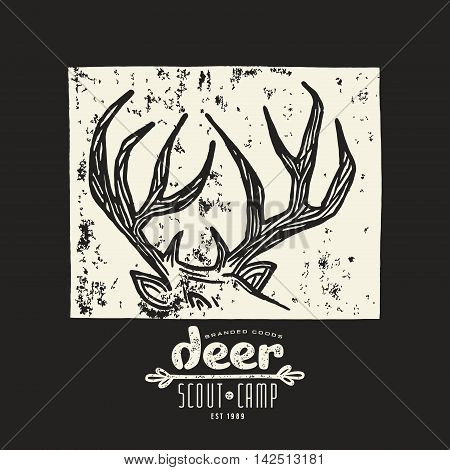 Stock vector linocut with a image of deer horns. Graphic design for t-shirt. White print on black background