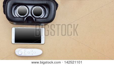 virtual glasses and bluetooth joy stick on brown paper background