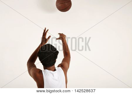 Handsome Young African American Throwing A Vintage Basketball