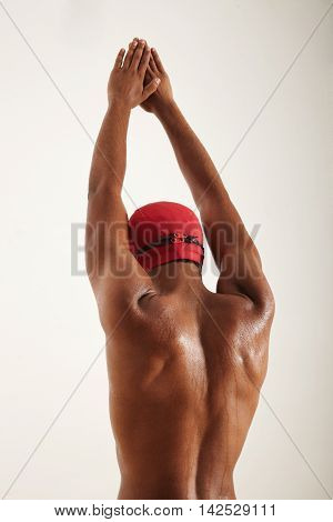 Young Black Swimmer Raising Hands Up To Dive