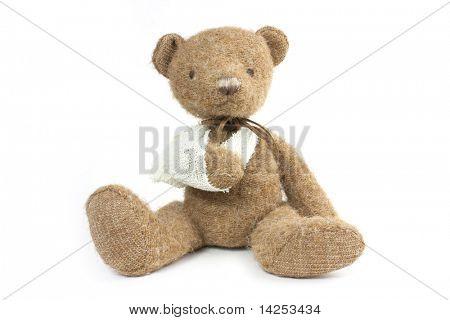 lindo oso de peluche con una fractura de brazo en cabestrillo