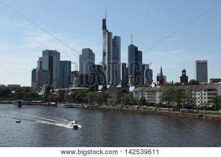 FRANKFURT AM MAIN, GERMANY - JUNE 14, 2015: Modern skyscrapers in the Bankenviertel (banking district) over the Main River in Frankfurt am Main, Hesse, Germany.
