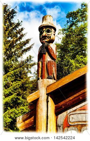 Ketchikan AK USA - May 24 2016: Native American Totems and Clan Houses located at Totem Bight State Historic Site.