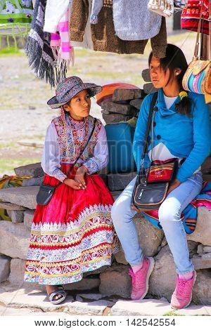 Maca, Peru-january 16: Unidentified Girls Sit At The Market On January 16, 2015 In Maca, Peru. Maca