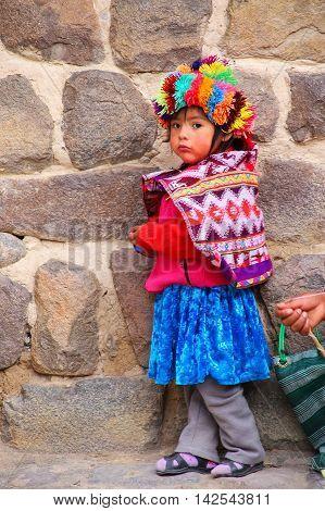 Ollantaytambo, Peru - January 17: Unidentified Girl Stands Near Inca Fortress On January 17, 2015  I