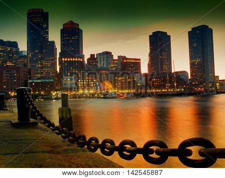 View of Financial District and Harbor at sunset in Boston Massachusetts USA