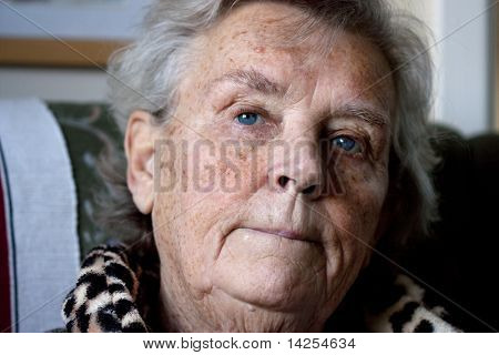 worried elderly lady with a pensive or thinking facial expression