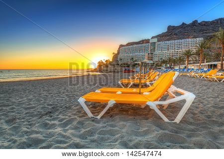 Deckchairs on the beach of Taurito at sunset, Gran Canaria