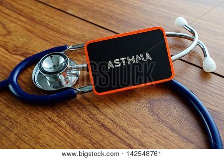 Medical Concept.word Asthma With Stethoscope On Wooden Table.