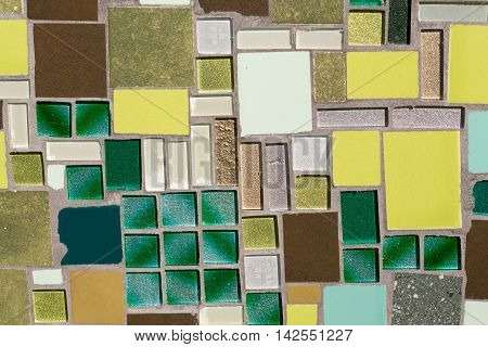 Colorful mosaic on the wall abstract glass background.