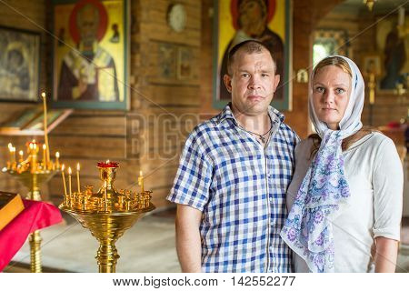 SOGINICY, RUSSIA - JUL 30, 2016: Unidentified parishioners of Church of Nichola. Church of St. Nicholas at Soginicy, the only surviving sample of a steepled Church prionezhskiy school, 1696 built.