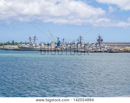 OAHU, HI - AUG 5, 2016: United States naval ships in Pearl Harbor on August 5, 2016 in Pearl Harbor, USA. Pearl Harbor is the headquarters of the United States Pacific Fleet.