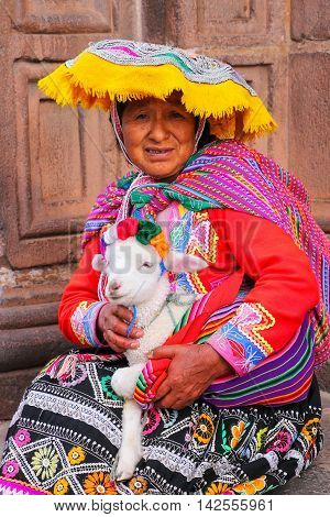 Cusco, Peru - January 20: Unidentified Woman In Traditional Dress Holds Lamb In The Street On Januar