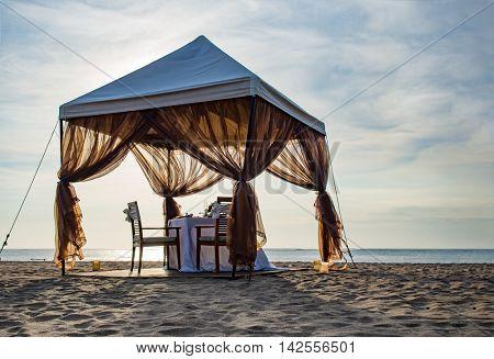 Romantic dinner table set on the beach