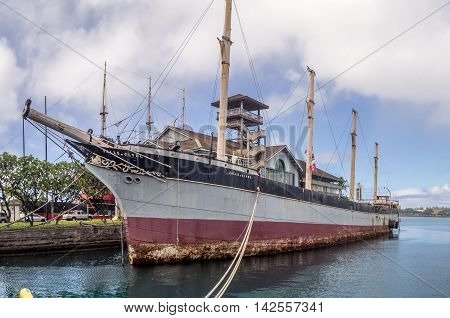 HONOLULU, HI - AUG 6: The sailing ship Falls of Clyde on August 6, 2016 in Honolulu Harbor. The ship is docked beside the Hawaii Maritime Center in Honolulu Harbor.