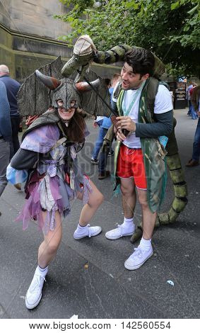 EDINBURGH- AUGUST 13: Members of Les Petits Theatre Company publicize their show Captain Flinn and the Pirate Dinosaurs during Edinburgh Fringe Festival on August 13, 2016 in Edinburgh, UK