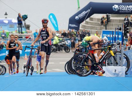 STOCKHOLM - JUL 02 2016: Triathlete Adam Bowden and competitors running with bicyle in the transition zone in the Men's ITU World Triathlon series event July 02 2016 in Stockholm Sweden