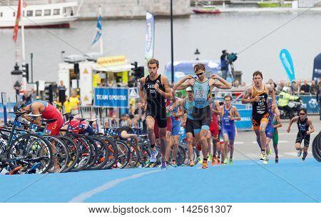 STOCKHOLM - JUL 02 2016: Tough fight between running triathletes Vanderplancke Steel Sagiv and competitors in the Men's ITU World Triathlon series event July 02 2016 in Stockholm Sweden