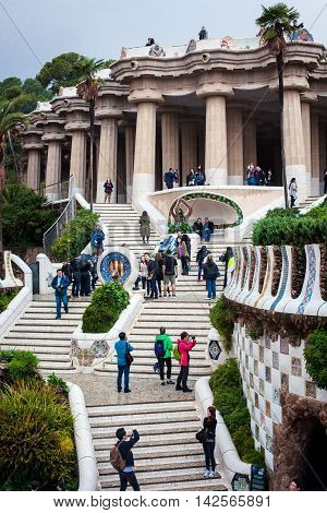 Barcelona Spain - Oct 27 2015: Tourists are visiting Park Guell in Barcelona on a rainy day. Park Guell is the famous architectural art designed by Antoni Gaudi.