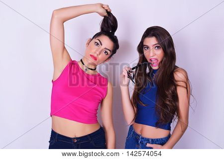 Preview Save to a lightbox  Find Similar Images  Share Stock Photo: Portrait of two beautiful women having fun together. Friendship concept. Trendy and stylish friends isolated over grey background.
