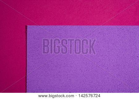Eva foam ethylene vinyl acetate sponge plush light purple surface on pink smooth background