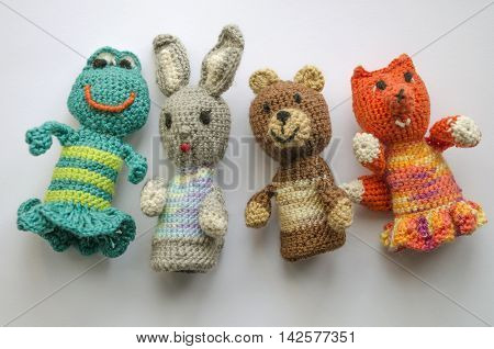 Finger animal puppets knitted from wool. Hand made. Crochet knitting cute teddy bear frog hare and fox. Knitted toys. Finger theater.