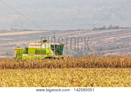 Harvester In The Field In Late Fall