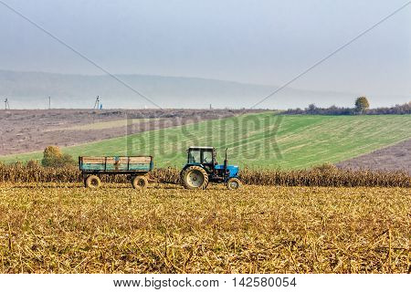 Tractor In The Field On Haze Day