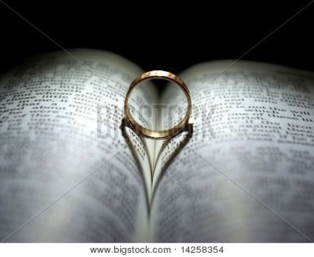Wedding Ring and heart shaped shadow over a Bible poster