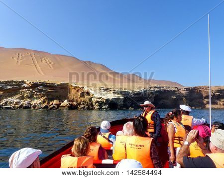 Paracas, Peru-january 26: Unidentified People Look At Candelabra Of The Andes From A Boat On January