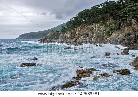 Storm on the rocky sea coast in Japan sea