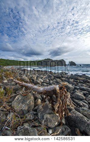 Grey pebbles and a tidal wave sea Japan