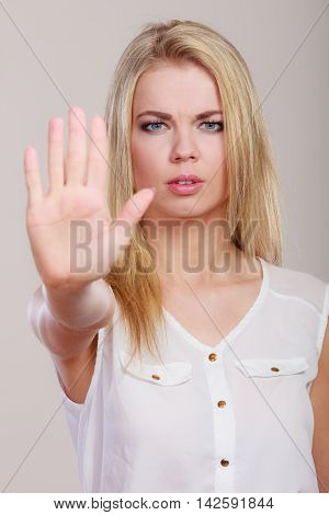 Girl Showing Stop Hand Sign Gesture.