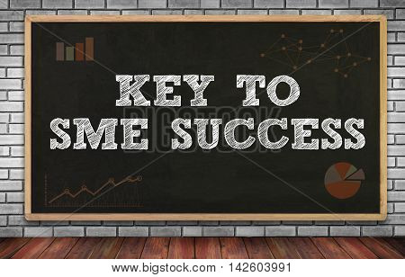 KEY TO SME SUCCESS Small and medium-sized enterprises on brick wall and chalkboard background poster