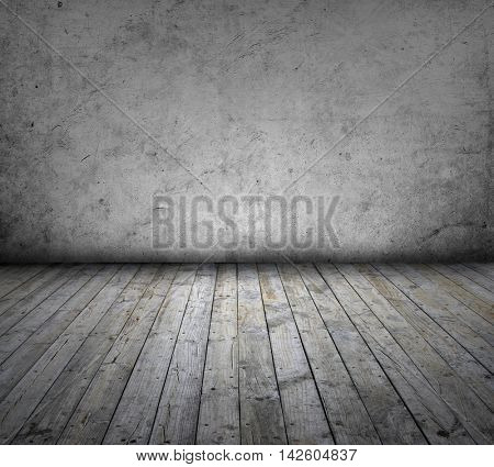 Wooden floorboards and grey wall