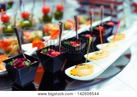 Various snacks on table, banquet food, toned image, grain added