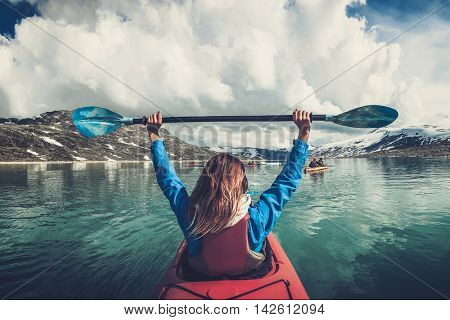 Woman kayaking on Styggvatnet glacier lake near Jostedalsbreen glacier. Norway.