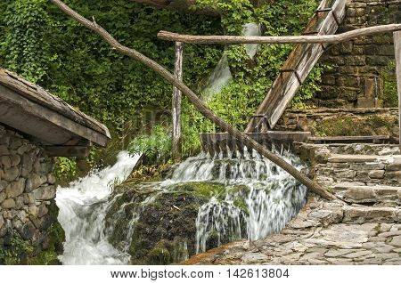 Old vintage wooden facility for washing of carpets and rugs powered by river water